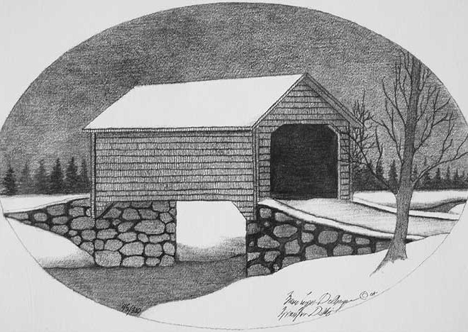 A covered bridge in snow